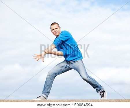 sport, dancing and urban culture concept - handsome boy making dance move