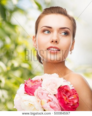 holidays, beauty and jewelry - woman with diamond earrings and flowers