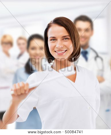 healthcare, medical and stomatology - dentist with toothbrush in hospital