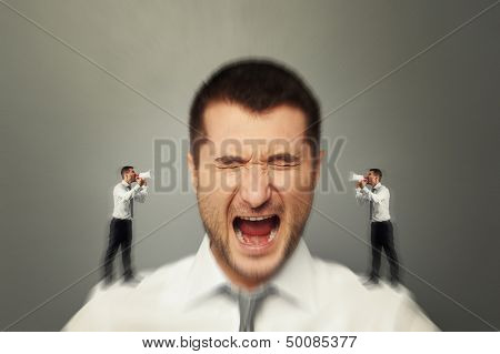 emotional man listening his inner voice over grey background