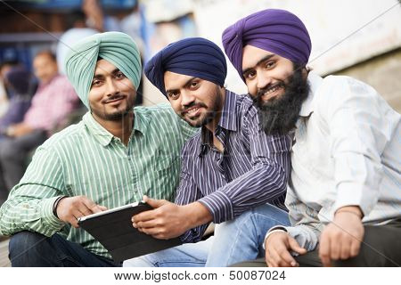 Group portrait of smiling authentic native indian punjabi sikh men in turban with bushy beard poster