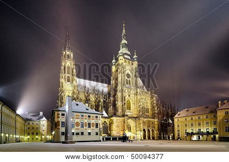 side view of St. Vitus Cathedral at winter night, in Prague