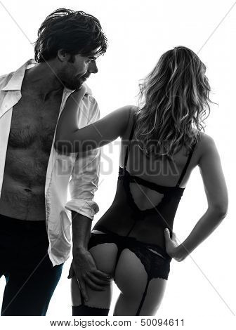 sexy stylish couple  caucasian in silhouette on white background