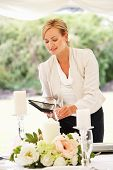 Wedding Planner Checking Table Decorations In Marquee poster