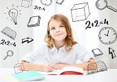 education and school concept - little student girl studying at school poster