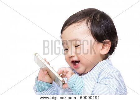 Asian baby boy play with mobile phone