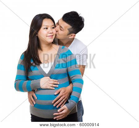 Asia pregnant couple kiss