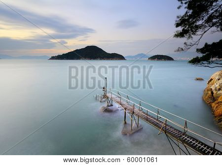 Seascape and wooden jetty