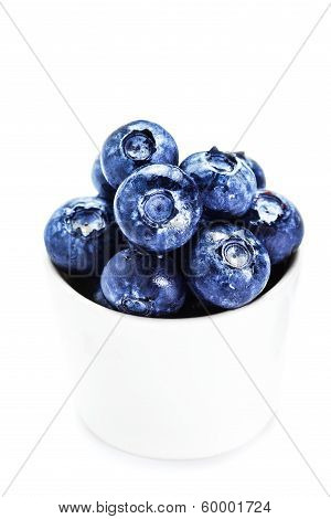 Fresh Blueberries In A Bowl  Isolated On White Background Close Up. Group Of Huge Blue Berries Macro
