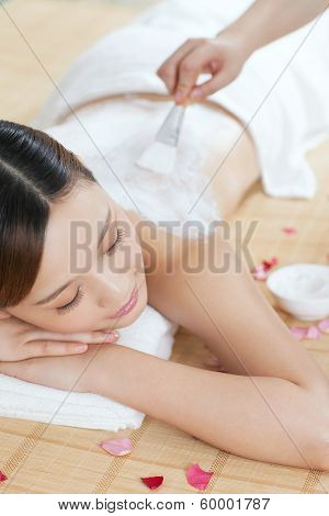 .a Young Lady Enjoy Body Mask In Spa Salon.