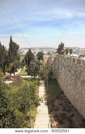 East Jerusalem from the walls surrounding the eternal city. Footpath through the park next to the historic walls