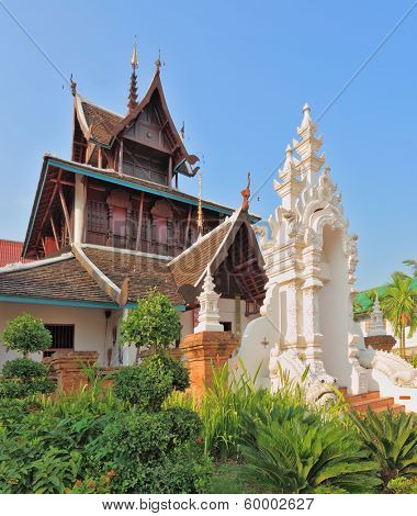 Magnificently decorated entrance to the temple in the north of Thailand. The temple is surrounded with fine tropical park