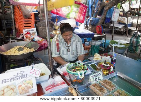 BANGKOK, THAILAND - JANUARY 24: Unknown vendors prepare and sell food on the street on Jan 24, 2014 in Bangkok, Thailand. Government figures indicate more 16,000 registered street vendors in Thailand.