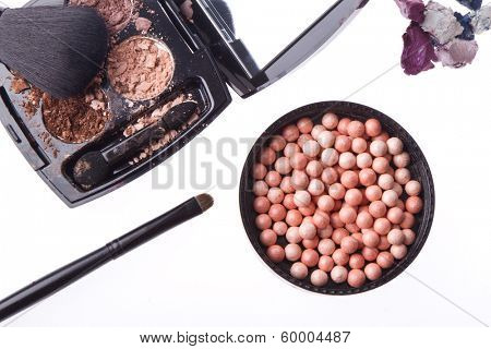 crushed compact eyeshadows with brush isolated on white background