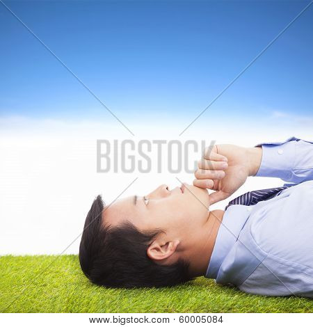 Young Businessman Thinking   And Contemplating On A Meadow