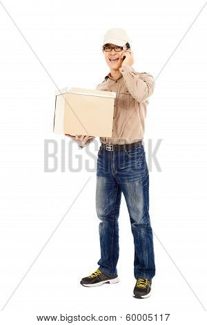 Delivery Man Talking With Phone And Holding Parcel