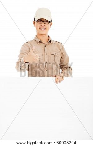 Confident Delivery Man Holding White Board And Thumb Up