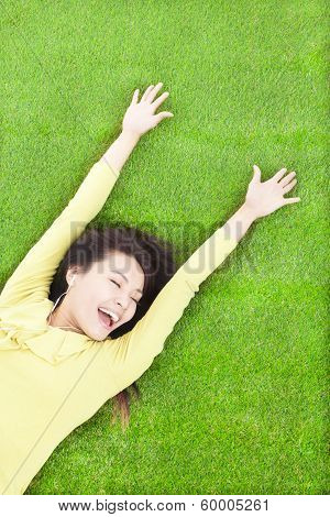 Happy Woman Relaxing  And Lying On A Meadow
