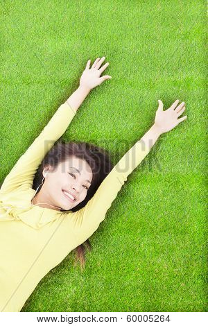 High Angle View Of  Pretty  Woman Relaxing And Lying On Grass