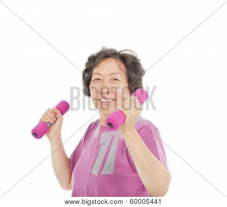 Smiling Senior Woman Working Out With Dumbbells