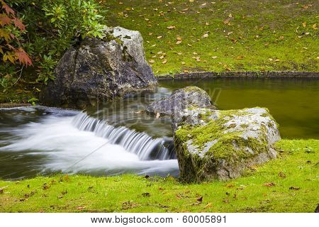 Small Waterfall In Japanese Garden