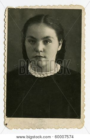 KURSK, USSR - CIRCA 1950: An antique photo shows studio portrait of a young woman.