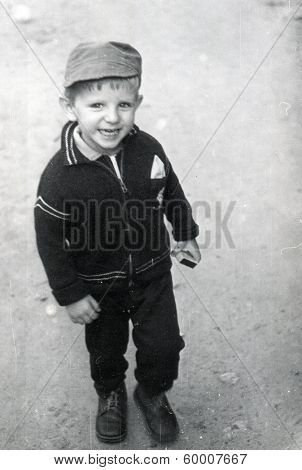 KURSK, USSR - CIRCA 1980: An antique photo shows portrait of a smiling little boy on the walk
