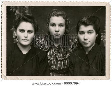 KURSK, USSR - CIRCA 1954: An antique photo shows studio portrait of three womans.