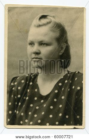 KURSK, USSR - CIRCA 1952: An antique photo shows studio portrait of a young woman.