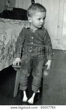 KURSK, USSR - CIRCA 1984 An antique photo shows portrait of a little boy