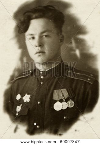 KURSK, USSR - CIRCA 1943: An antique photo shows portrait of a Soviet Army lieutenant in uniform.