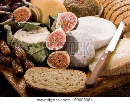 slice bread with an assortment of cheeses and fruits