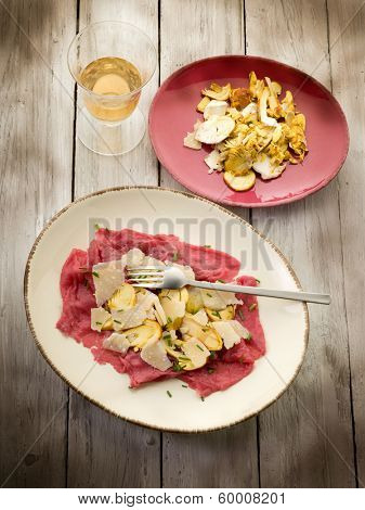 beef carpaccio with slice ovum mushroom and  parmesan flake