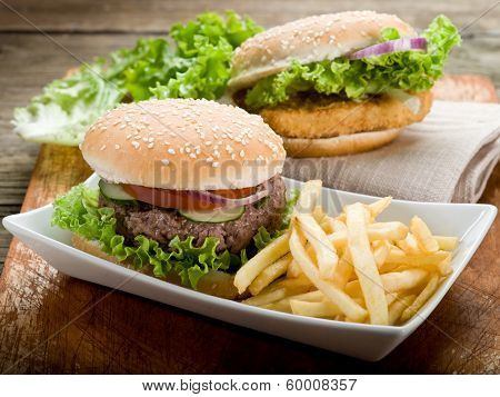 sandwich with hamburger and fried potatoes