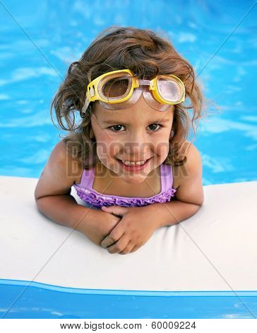 a little girl in a swimming pool