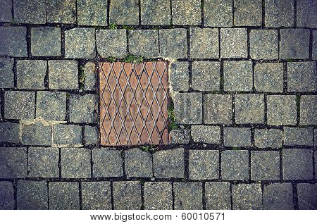 Paving Stones Background With Metal Plate