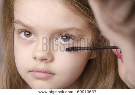 Makeup Artist Paints Eyelashes On Girl's Face