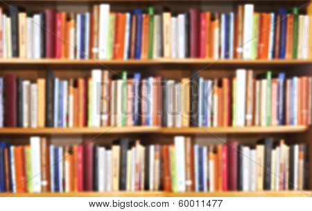 Blured books in public library. Blured effect. Background for you pictures