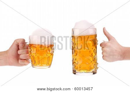 Two full beer mugs in hand.