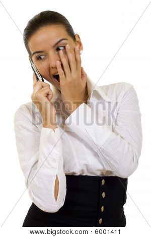 Attractive Businesswomanon Phone Looking Shoked