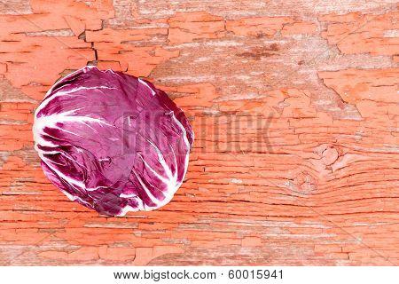 Variegated Radicchio On Grungy Rustic Wood