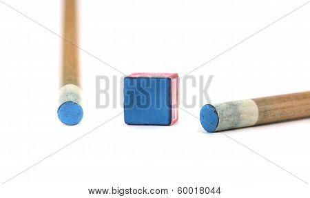 Cue sticks with chalk block.