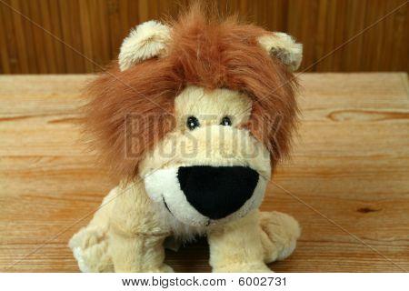 Closeup Plush lion mascot. Cheerful animals king poster