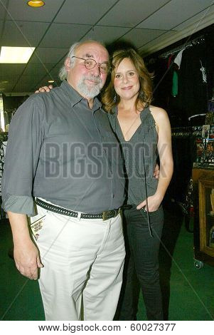 BURBANK, CA - FEBRUARY 16: Stuart Gordon and Laura Niemi attend the