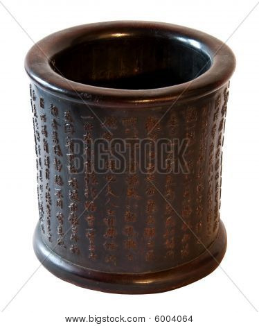 Chinese traditional decorative pot in wood with carved ideograms and inscriptions