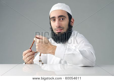 Arabian religious muslim man holding a rosemary