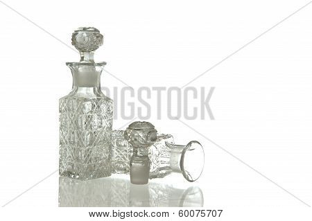 Two decorative glass carafe and plug