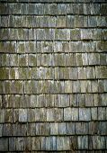 A Background Texture Of Wooden Roofing Shingles poster