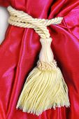 close up of the red curtain with tassel poster