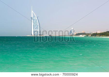 DUBAI, UAE - 2 APRIL 2014: Public Jumeirah Beach in Dubai, UAE. Jumeirah Beach is a white sand beach that is located and named after the Jumeirah district of Dubai.